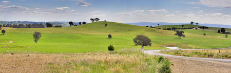 hillsides: Rolling hillsides and meandering country roads in country NSW, Australia.  (3 image stitch panorama)