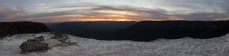 Sunset from Flat Rock, now renamed to Lincolns Rock in honour of Lincoln Hall who survived Everest after being pronounced dead.  The rock juts out from the Kings Tableland at Wentworth Falls and overlooks Jamison Valley.  Panorama