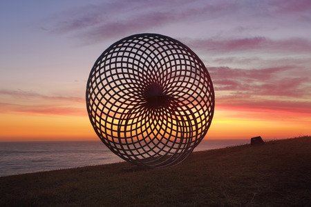 titled: BONDI, AUSTRALIA - 23 OCTOBER, 2014; Sculpture by the Sea Annual Event 2014.  Sculpture titled Sisyphus by George Andric, SA.  Materials, stainless steel.  Price $36000