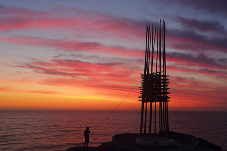 titled: BONDI, AUSTRALIA - 23 OCTOBER, 2014; Sculpture by the Sea Annual Festival Event 2014.  Sculpture titled Save Our Souls by Cave Urban, NSW.  Silhouette against a sunrise sky. Materials, bamboo, rope,  steel, LED lights.   Price $30000 Editorial