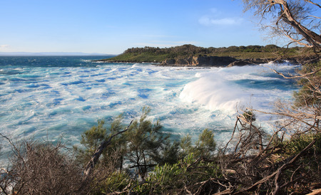 gusty: Strong gusty winds whipped up huge surf and turbulent rough seas at Jervis Bay.  View to  Bowen Island
