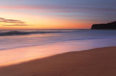 southward: Stunning sunrise at Bungan Beach on Sydneys northern beaches with views southward toward Mona Vale headland