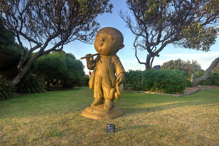 ascetic: BONDI, AUSTRALIA - OCTOBER 23, 2014; Sculpture by the Sea .  Sculpture titled The Ascetic  by LNaidee Changmoh, Thailand   Made from painted bronze. - Keep the mind close to peace, philosophy