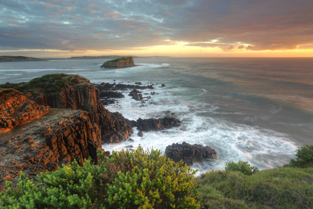 Magnificent sunrise morning and beautiful soft sunlight highlighting the rocks at Minamurra, Australia   Stock Photo
