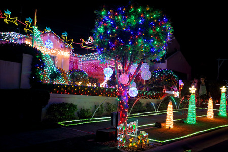 holiday lights display: BEAUMONT HILLS, AUSTRALIA - DECEMBER 24, 2015;  Over 60000  Christmas lights decorations on house and manicured gardens create a joyful wonderland and  draw crowds of visitors each year.  The christmas display helps raise money  for charity by generous do