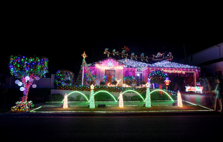 christmas display: BEAUMONT HILLS, AUSTRALIA - DECEMBER 24, 2015;  Over 60000  Christmas lights decorations on house and manicured gardens create a joyful wonderland and  draw crowds of visitors each year.  The christmas display helps raise money in the community for charit