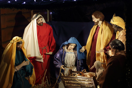 christ is born: QUAKERS HILL, AUSTRALIA - DECEMBER 24 2014;  Nativity scene Mary, birth of Jesus in manger with Wise Men in stable  worship gifts. Editorial