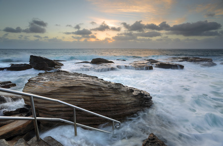 giles: Giles Baths  at Coogee  is known as a bogey hole – a semiformal rock pool open to the surging surf. In calm seas and low tide is a serene idyllic rockpool suitable for children but can also be a rough and tumble whitewater washing machine in high and  t