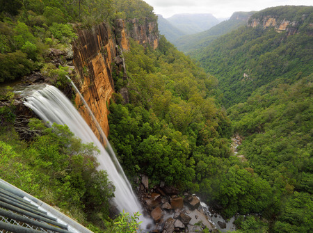 fitzroy: Views of Fitzroy Falls from the grated balcony lookout at the top of the escarpment with a downward perspective capturing the spectacular falls into the eucalypt forests of the valleys below.  Morton National Park.