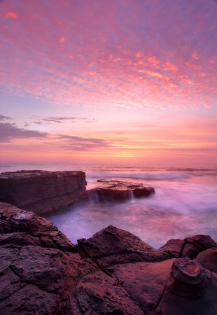 behold: Sunrise with beautiful skies and ocean flows at the North Avoca rock shelf. Central Coast, Australia.    A beautiful morning to behold