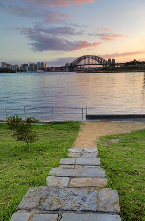 sunup: Sunrise behind the Sydney Harbour Bridge from Illoura Reserve, East Balmain, Australia