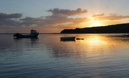 kiama: Boats bob on the water at sunrise.  Minamurra NSW Australia Stock Photo