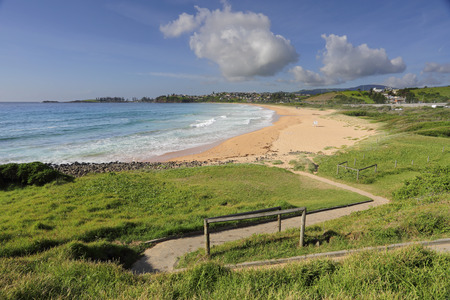 kiama: The zig-zag path leads down to Bombo Beach on the south coast of NSW Australia on a beautiful summer morning, with empty lifeguard chair
