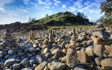 sightsee: Mimosa Rocks in Mimosa Rocks National Park, contains a variety of cliffs, sea caves, lagoons, beaches, estuaries and wetlands.  Aborigine occupation dates from 6000-25000.  It was a meeting ceremonial place for tribes as far as inland NSW. Stock Photo