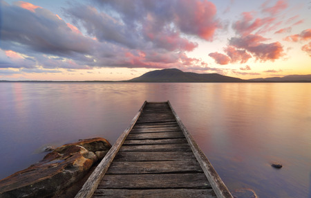 Queens Lake Jetty at Queens Lake Nature Reserve picnic area in Jolly Nose NSW at sunset. Stock Photo