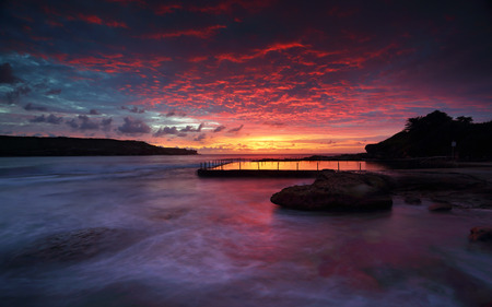 long bay: Magnificent sunrise and stunning colour over Malabar ocean rock pool,  in Long Bay, Sydney.