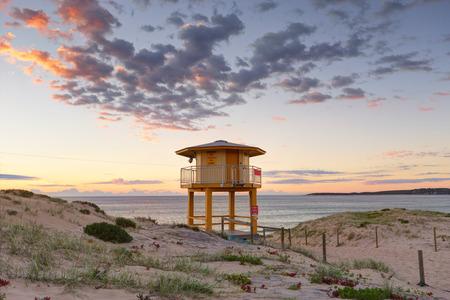 Wanda Beach Lifeguard lookout tower with sunrise skies photo