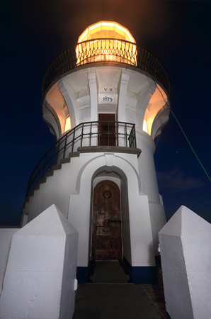 body built: Sugarloaf Point Lighthouse at night, located at Seal Rocks in the Myall Lakes National Park.  This lighthouse has an amazing external staircase that wraps around its body. Built in 1875 it sits on the top of  steep sheer cliffs and jagged and inclined roc