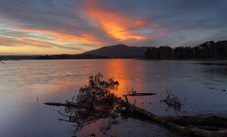 signifies: Mount Gulaga is one of the highest mountains  on the south coast and has a specific importance to indiginous Australians as it signifies mother. Stock Photo