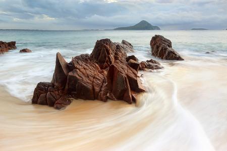 shoal: Water flow around rocks at Shoal Bay Australia