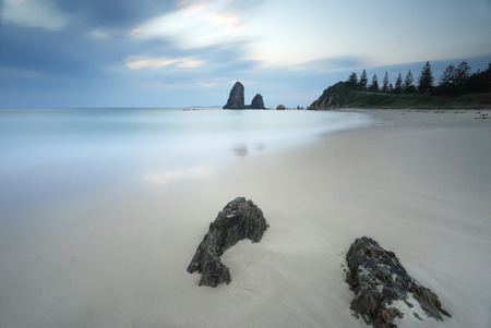 wispy: Long exposure taken at Glasshouse Rocks, the smooth surreal ocean and wispy clouds contrast to the sharp details of the foreground rocks.  The filter adding a vignette to the scene