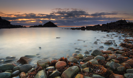 greys: A long exposure dawn shot of first light at Mimosa Rocks in Mimosa Rocks National Park at Aragunnu.  A feature of this beach is its colourful boulder stones, ranging from whites,  a myriad of reds, yellows, greys and black.  You will see many ever changin