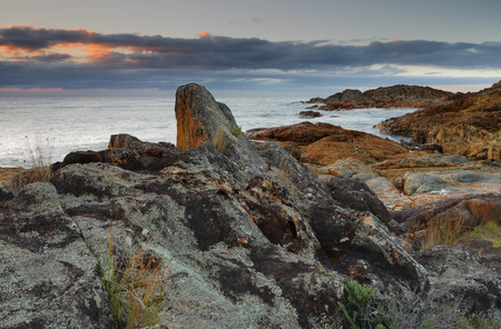 exist: Sunrise skies at Mimosa Rocks, Mimosa Rocks National Park. Various rocks and geological formations as well as aboriginal middens exist and are preserved  here.