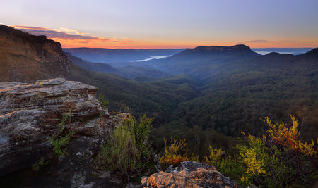 sensational: Sunrise from Narrowneck overlooking the Jamison Valley, a light fog and mist as first rays of sunlight strike the escarpment.  Mt Solitary in the distance.