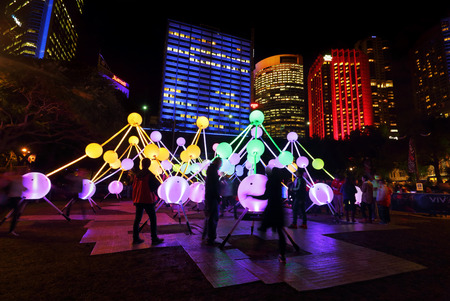 affinity: SYDNEY, AUSTRALIA, MAY 25, 2015:  Tourists and local public enjoy the Affinity installation at Vivid Sydney, which  depict the dazzling complexity and connectivity of the human brain and neurons.  When stimulated by touch, the orbs set-up a striking displ Editorial
