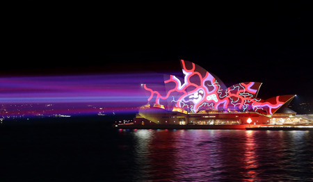 light beams: SYDNEY, AUSTRALIA - MAY 25, 2015;   Light beams stream onto the iconic landmark, the Sydney Opera House casting various moving patterns during Vivid Sydney annual festival event. Super high ISO to freeze the pattern Editorial