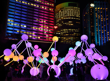 depict: SYDNEY, AUSTRALIA, MAY 25, 2015:  Tourists and local public enjoy the Affinity installation at Vivid Sydney, which  depict the dazzling complexity and connectivity of the human brain and neurons.  When stimulated by touch, the orbs set-up a striking displ Editorial