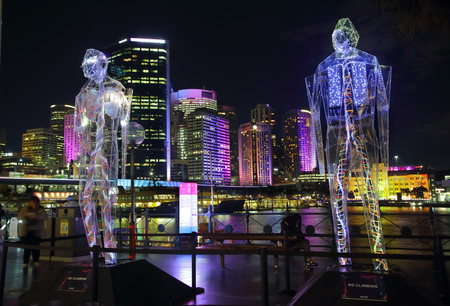 reveals: SYDNEY, AUSTRALIA - MAY 27, 2015, Sydney Vivid exhibit, Exposed reveals the interior worlds of three giant humanoid figures, each of which is transparent.
