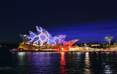 light beams: SYDNEY, AUSTRALIA - JUNE 2, 2015;   Light beams stream onto the iconic landmark, the Sydney Opera House casting various moving patterns during Vivid Sydney annual festival event.