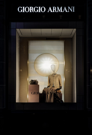 shop window display: SYDNEY, AUSTRALIA, MAY 26, 2015;  Retail shop window display of female clothing and accessories and visual merchandising of Giorgio Armani, Sydney