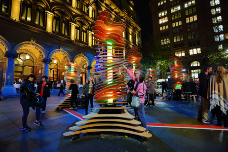 soothing: SYDNEY, AUSTRALIA - MAY 26, 2013;  Visitors interact with Robotanic in Martin Place, part of Vivid Sydney. When touched light and soothing chimes of nature sound.  Artist:  Thomas Martin  Sebastian Barkoczy