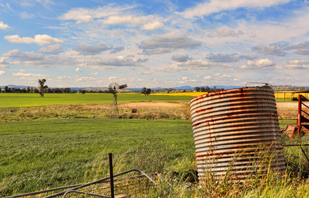 disused: Abandoned disused farmland and rusty farm equipment in rural Australia Stock Photo