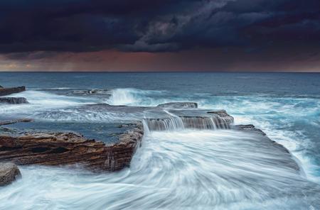 turbulent: Stormy sunrise skies and turbulent seas at Maroubra