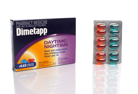 antihistamine: SYDNEY, AUSTRALIA - JULY 20, 2015;  Box and blister pack of Dimetapp day and night capsules for fever, aches, cold and flu with paracetamol and antihistamine.  Shot in studio isolated on white background.