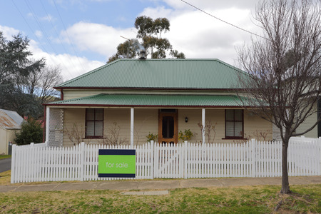 cottage fence: Beautiful well looked after cottage house with white picket fence for sale in rural Australia