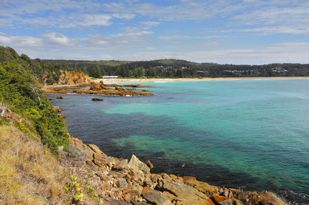 south coast: Tathra is a seaside village on the far south coast, called the Sapphire Coast in the Bega Valley shire.  Views from the rocky headland looking back towards Tathra beach.on a beautiful sunny day