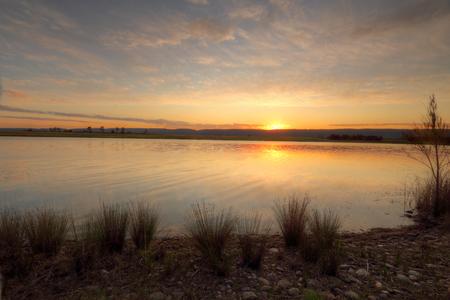 quietude: Sunset across Duralia Lake in Penrith, NSW Australia Stock Photo