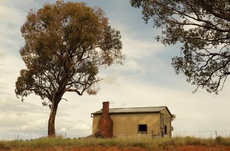 dwelling: Abandoned old dwelling with brick chimney in rural NSW town of Mandurama, Australia Stock Photo