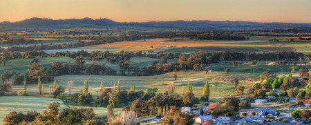 australia landscape: Sunlight across the frosty fields around  the Cowra district just after the first rays of sunlight burst forth from the ranges.