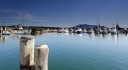 moorings: Bermagui Harbour from the promenade and Mount Gulaga in the distance.   The name is from from the Dyirringanj word, permageua, meaning -  canoe with paddles,