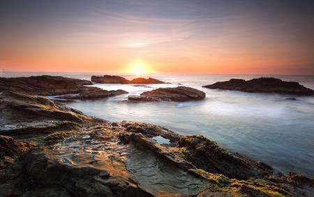 south coast: Sunrise over the ocean and the Bermagui coastline, south coast NSW, Australia