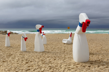 BONDI, AUSTRALIA - OCTOBER 22, 2015;  Annual Sculpture by the Sea public event.  Exhibit titled  The Bottles by RCM Collective.  Human sized spray and wipe cleaning bottles Editorial