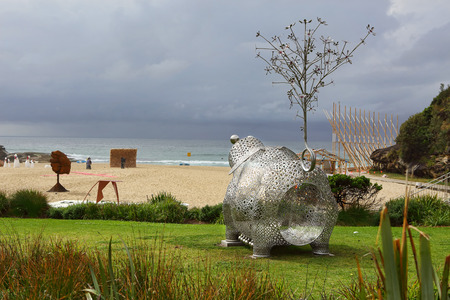 titled: BONDI, AUSTRALIA - OCTOBER 22, 2015;  Annual Sculpture by the Sea free public event.  Exhibit titled Pig of Fortune 2 by Tae Geun Yang.  Stainless steel and granite construction symbol of fortune and fecundity