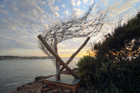 sculpture: BONDI, AUSTRALIA - OCTOBER 25, 2015;  Annual Sculpture by the Sea free public event.  Exhibit titled Windspiral VI the wind is your breath by Bronwyn Berman.   Decorative metal work and timber