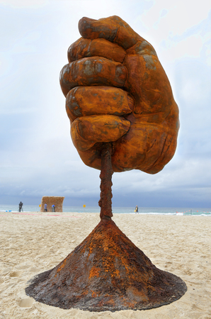 titled: BONDI, AUSTRALIA - OCTOBER 22, 2015;  Annual Sculpture by the Sea free public event.  Exhibit titled  Dust by Norton Flavel.  Weathered steel fist.