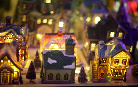 christmas lights display: LALOR PARK, AUSTRALIA - DECEMBER 24, 2014;  Miniature European Christmas village scene with twinkling lights at night window display